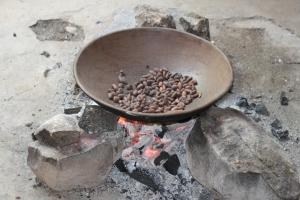 roasting the beans over the fire